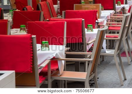 Empty Sidewalk Cafe With Chairs