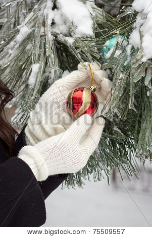 Woman Decorates A Fir Tree