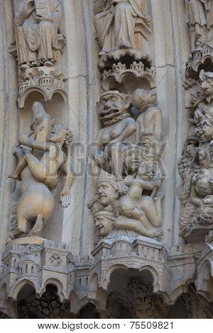 Paris - West facade of Notre Dame Cathedral. Archivolts of The Last Judgment portal