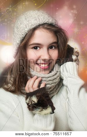 Fashionable Teenage Girl Wearing Cap And muffler Coat In Studio With Snow.Portrait of young girl