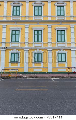 Yellow apartment with green wooden