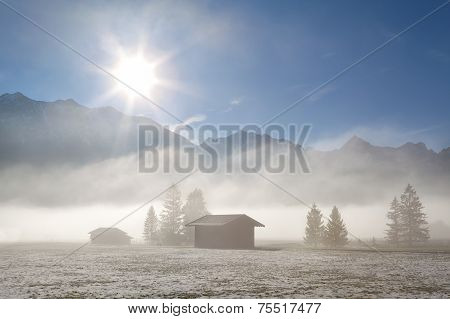 Foggy Sunny Morning Pver Winter Alpine Meadows