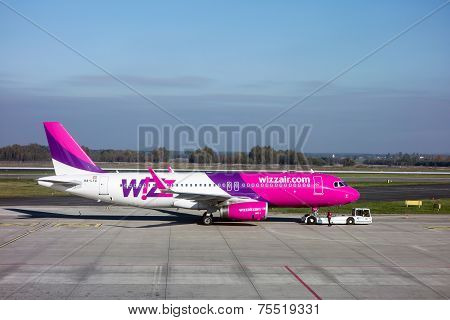 Wizzair Aircraft Towed By The Service Truck