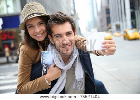 Tourists in Manhattan showing New York pass