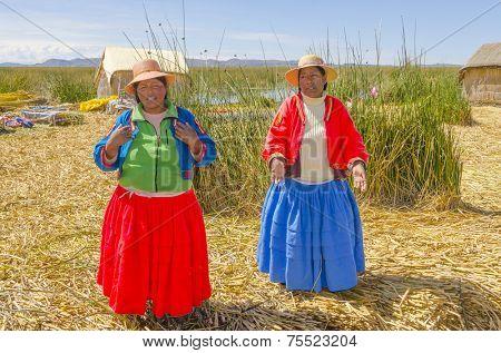 PUNO, PERU, MAY 5, 2014: Uros islands on Titicaca lake - Local women sing welcoming tourists visiting islands