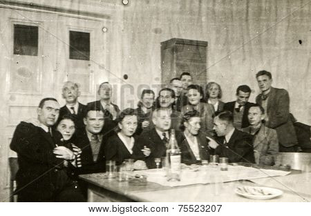 POLAND, CIRCA FORTIES: Vintage photo of group of people partying