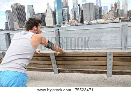 Man stretching out after training on Brooklyn Heights promenade