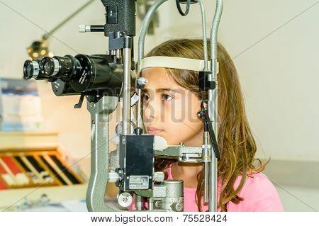 Little girl is having the eye exam