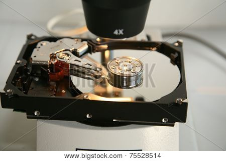 A Genuine Computer Hard Drive is repaired with the help of a Microscope. Microscopes are used to see images up to 400 times larger than with the naked eye, revealing defects and damage for repair