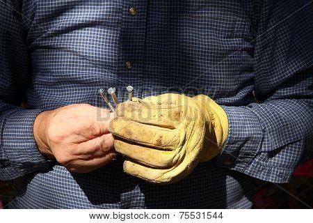 Workman With Metal Screws