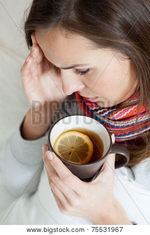 Drinking Hot Tea With Lemon And Honey
