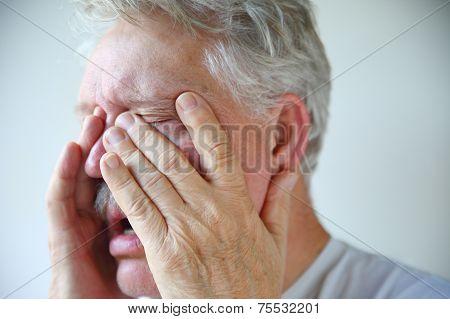Cold Or Flu Symptoms In A Senior Man