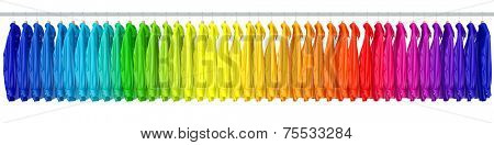 Many shirts assorted in rainbow colors on a long clothes rack (3D Rendering)