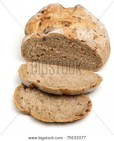 Sliced artisan bread loaf on white background