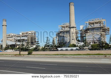 HUNTINGTON BEACH, CA - NOVEMBER 6, 2014: The AES Power Plant on Pacific Coast Highway. The natural gas plant produces electricity for more than 40,000 homes.