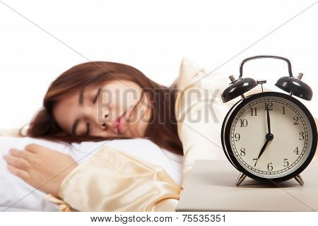 Sleeping Asian Girl With Alarm Clock
