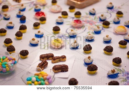Birthday table with many delicious candies