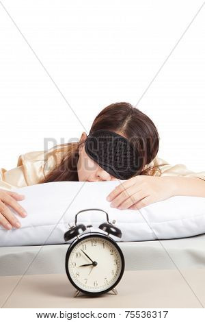 Sleepy Asian Girl With Eye Mask And Alarm Clock