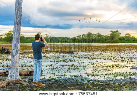 Tourist looks the Pantanal area. Pantanal is one of the world's largest tropical wetland areas located in Brazil , South America
