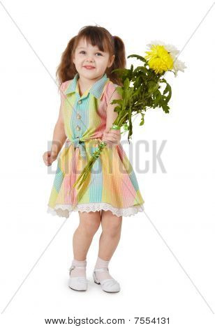 Happy Little Girl With A Bouquet Of Flowers