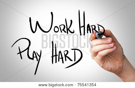 Hand writing with a black mark on a transparent wipe board - Work Hard, Play Hard