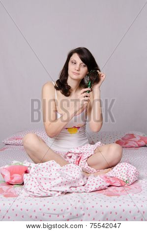 Girl Combing Her Hair In The Morning