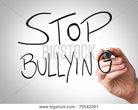 Hand writing with black and blue marker on transparent wipe board - Stop Bullying
