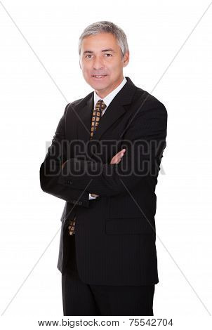 Businessman Standing Arms Crossed Against White Background