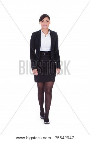Businesswoman Walking Over White Background