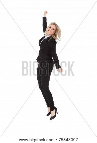 Cheerful Businesswoman Jumping Against White Background