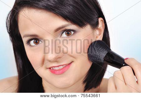 Woman With Makeup Brush
