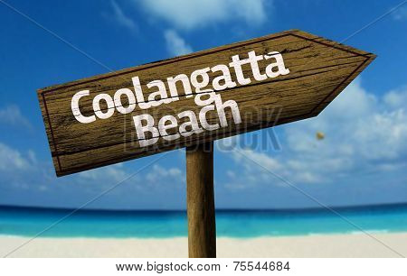Coolangatta Beach, Australia wooden sign with a beach on background