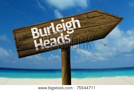 Burleigh Heads, Australia wooden sign with a beach on background