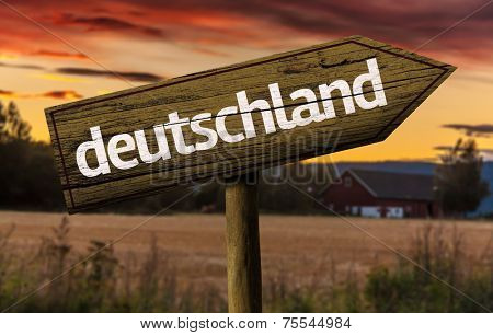 Deutschland wooden sign in a rural background