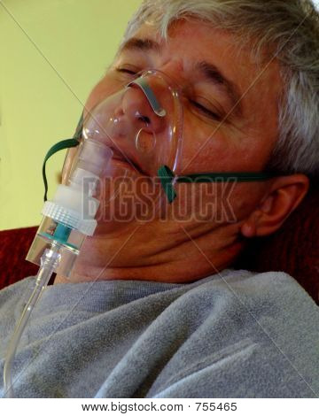 Ill Senior Man with Oxygen Mask
