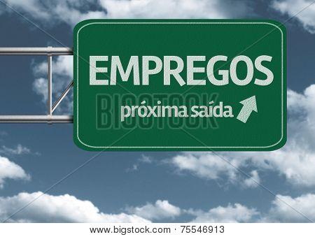 Empregos, proxima saida (Jobs, next exit in portuguese) creative road sign and clouds