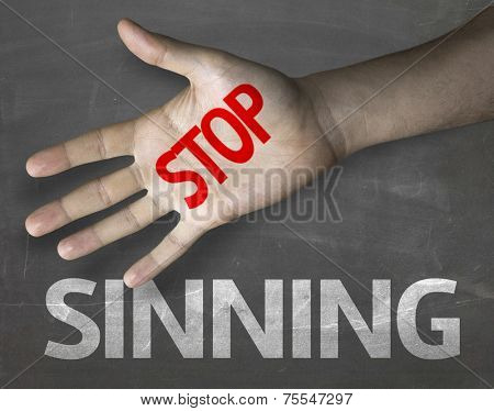 Educational and Creative composition with the message Stop Sinning on the blackboard