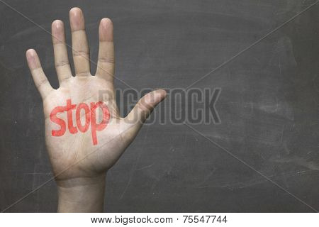 Educational and Creative composition with a hand painted Stop in red on the blackboard