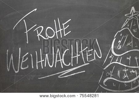 Christmas tree on blackboard and the text Frohe Weihnachten ( Merry Christmas in German )
