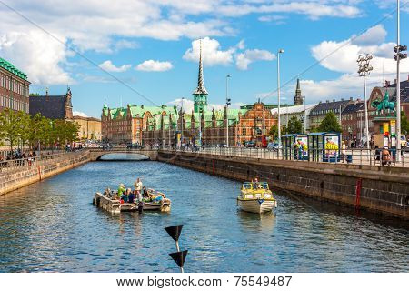 COPENHAGEN, DENMARK - MAY 8: Unknown tourists touring the Old Canal in Copenhagen, Denmark on May 8, 2013. A 60-minute guided tour costs US$10 for adults & US$7 for children aged 3 -11.