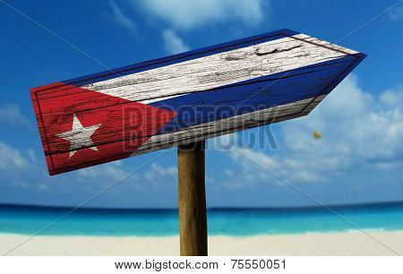 Cuba wooden sign with a beach on background - Central America