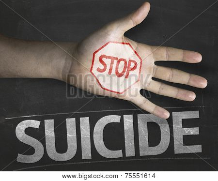 Educational and Creative composition with the message Stop Suicide on the blackboard