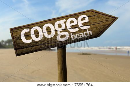 Coogee Beach on New South Wales, Australia wooden sign with a beach on background