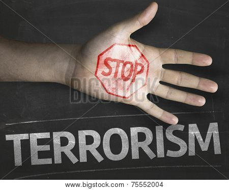 Educational and Creative composition with the message Stop Terrorism on the blackboard