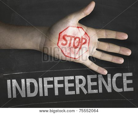 Educational and Creative composition with the message Stop Indifference on the blackboard