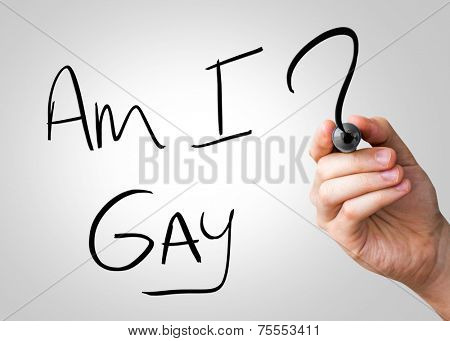 Am I Gay hand writing with a black mark on a transparent board