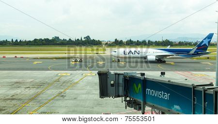 BOGOTA, COLOMBIA - NOV 18: Lan Chile airplane in Eldorado Airport on November 18, 2013 in Bogota, Colombia. Lan Chile is the main air company in Chile