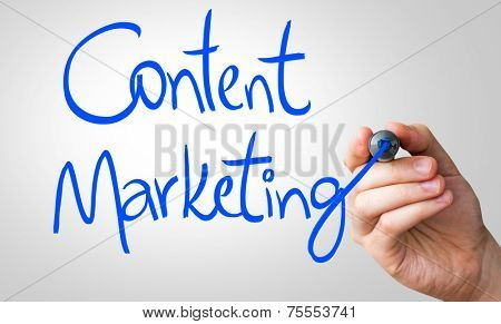 Content Marketing hand writing with a blue mark on a transparent board