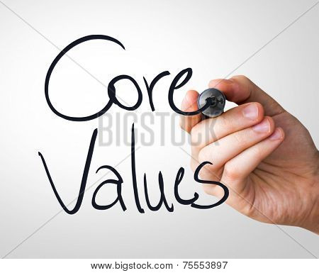 Core Values hand writing with a black mark on a transparent board