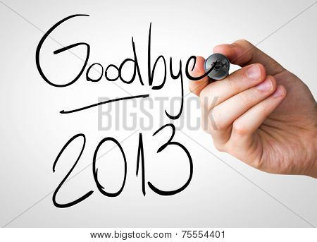Goodbye 2013 hand writing with a black mark on a transparent board